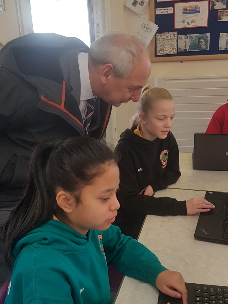 Pupils at Glyncollen Primary school engaging with Mike Hedges - Welsh Assembly Member
