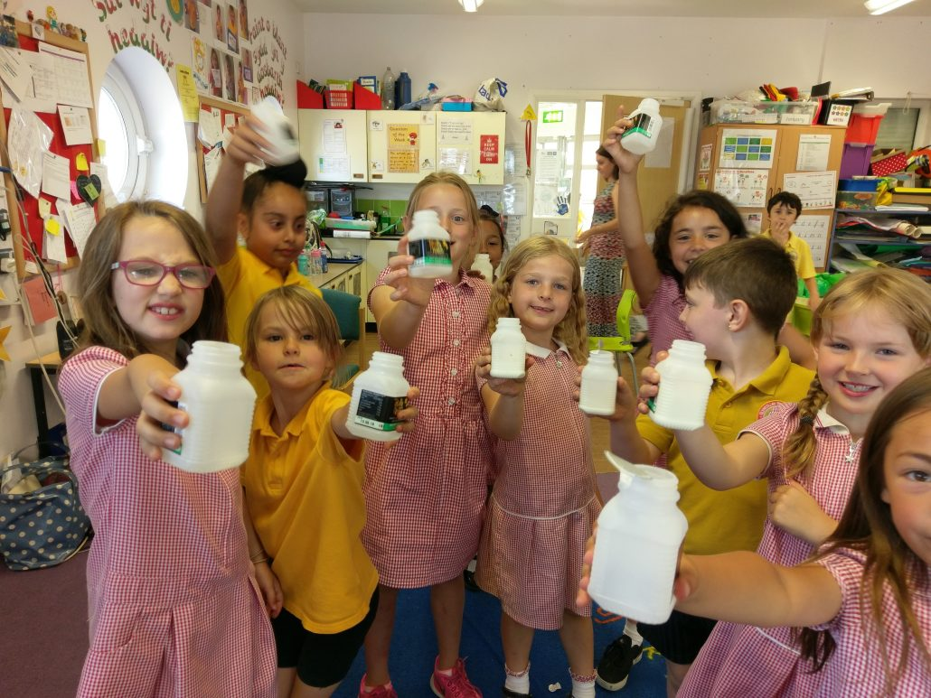 Glyncollen Primary school pupils with 150ml milk bottles